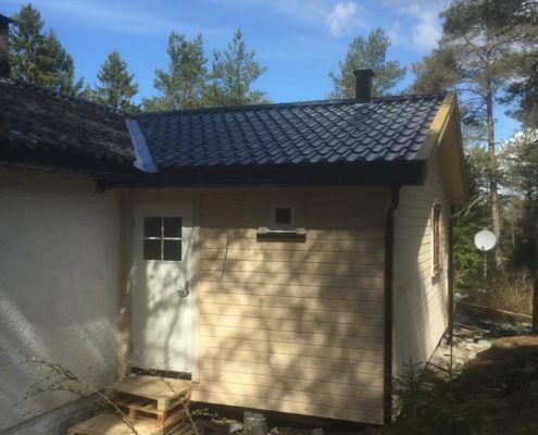 Byggmester Helle tilbygg på hytte
